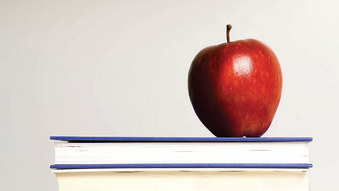 Picture of an apple on a stack of books